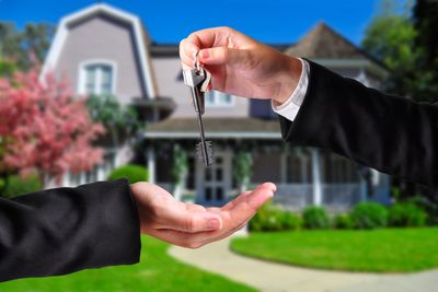 Handing over keys to a house